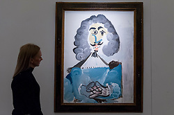 """© Licensed to London News Pictures. 08/04/2016. London, UK. A Sotheby's staff member views Pablo Picasso's """"Mousquetaire"""", 1967, est. $5-7million.  Sotheby's auction preview, at their New Bond Street gallery, of works to be in the upcoming New York Impressionist, modern and contemporary art sale. Photo credit : Stephen Chung/LNP"""