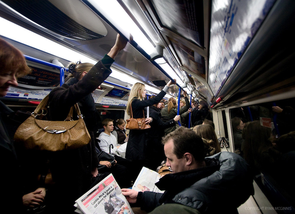 Passengers on the tube in London, December 5, 2007.