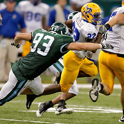 Sep 26, 2009; New Orleans, LA, USA;  McNesse State Cowboys running back Todd Pendland (22) runs away from Tulane Green Wave defensive end Logan Kelley (93) at the Louisiana Superdome. Tulane defeated McNeese State 42-32. Mandatory Credit: Derick E. Hingle-US PRESSWIRE