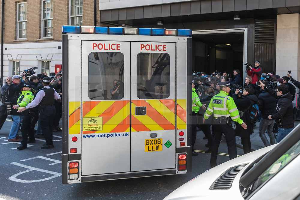 © Licensed to London News Pictures. 11/04/2019. London, UK. Journalists try to photograph and film Wikileaks founder Julian Assange as he arrives at Westminster Magistrates Court in a police escort to appear where he faces an extradition warrant. Photo credit: Rob Pinney/LNP