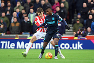 Kelechi Iheanacho of Manchester City shields the ball from Philipp Wollscheid of Stoke City. Barclays Premier league match, Stoke city v Manchester city at the Britannia Stadium in Stoke on Trent, Staffs on Saturday 5th December 2015.<br /> pic by Chris Stading, Andrew Orchard sports photography.