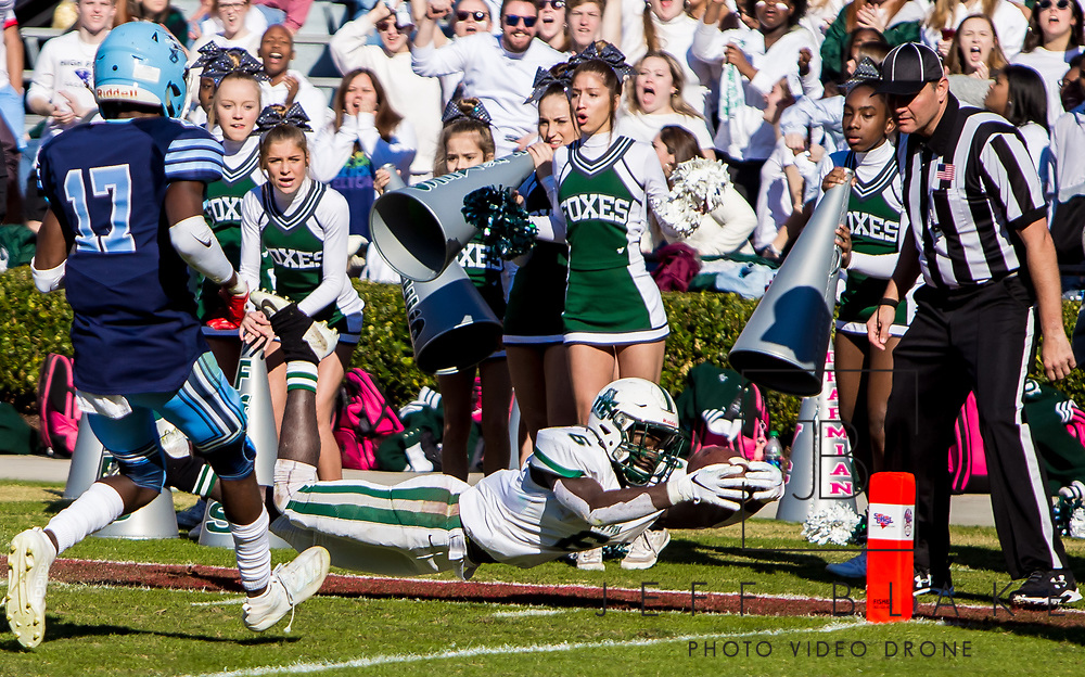 Dutch Fork Silver Foxes Jonathan Hall (6) lays out for a touchdown against the Dorman Cavaliers in the Class AAAAA State Championship Game at Williams-Brice Stadium in Columbia, SC. Dutch Fork wins their 4th straight state championship at Williams Brice Stadium. Photos ©JeffBlakePhoto.com