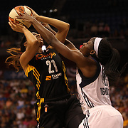 Chiney Ogwumike, (right), Connecticut Sun, is called for a foul while defending the basket against Jennifer Lacy, Tulsa Shock, during the Connecticut Sun Vs Tulsa Shock WNBA regular season game at Mohegan Sun Arena, Uncasville, Connecticut, USA. 3rd July 2014. Photo Tim Clayton