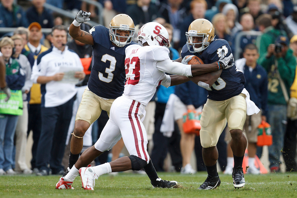Stanford safety Austin Yancy (#23) tackles Notre Dame tailback Cierre Wood (#20) during NCAA football game between Stanford and Notre Dame.  The Stanford Cardinal defeated the Notre Dame Fighting Irish 37-14 in game at Notre Dame Stadium in South Bend, Indiana.