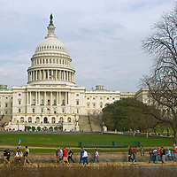 Tourists walk in front of the U.S. Capitol building in Washington, DC.