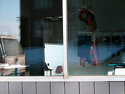 Interesting perspective and reflections within a yoga studio window vignette