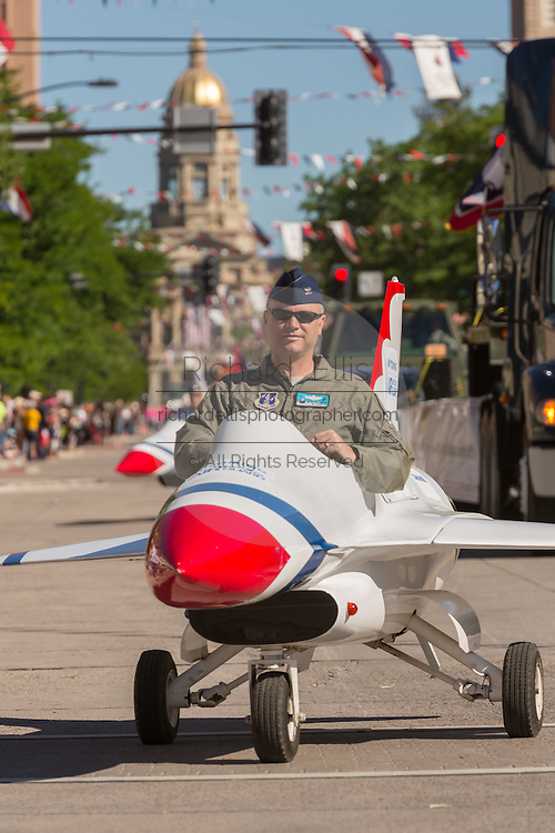 An Air Force officer rides in a miniature fighter jet during the Cheyenne Frontier Days parade through the state capital July 23, 2015 in Cheyenne, Wyoming. Frontier Days celebrates the cowboy traditions of the west with a rodeo, parade and fair.