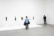 Alberto Giacometti exhibition at the Gagosian Gallery in London, England, United Kingdom. People interacting with the sculptures within this white art gallery space. Swiss sculptor and painter. His most typical works are emaciated and extremely elongated human forms.