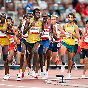 TOKYO, JAPAN August 3:    Mohamed Mohumed of Germany,  Isaac Kimeli of Belgium, Paul Chelimo of the United States and Joshua Cheptegei of Uganda in action during the Men's 5000m round one heat two race at the Olympic Stadium during the Tokyo 2020 Summer Olympic Games on August 3rd, 2021 in Tokyo, Japan. (Photo by Tim Clayton/Corbis via Getty Images)