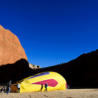 120613       Cable Hoover<br /> <br /> Balloonists begin to setup during the Red Rock Balloon Rally at Red Rock Park in Gallup Friday. Only a small group of balloons began to inflate before the launch was cancelled.