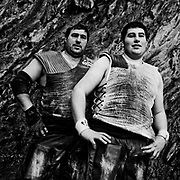 """Juan Jose Unanua """"Goenatxo"""", stone lifter or harrijasotzaile in Basque language, with his son Jon. Training at home in Azkoitia. Basque rural sports (Herri Kirolak in basque language) are rooted in traditional lifestyles, mostly farmer occupations of the Basque Country, in Northern Spain. Nowadays they have transform themselves into sports based in strenght and skill. Stone lifting and wood chopping are the most popular."""