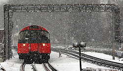© Licensed to London News Pictures. 18/01/2013. London, UK A Piccadilly Line tube train in the snow. Snow in West London today 18th January 2013. Photo credit : Stephen Simpson/LNP
