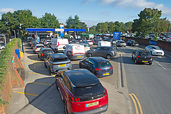 © Licensed to London News Pictures 24/09/2021.<br /> Sidcup, UK, Motorists queuing for up to an hour at Tesco Petrol station in Sidcup, South East London. Chaos at the forecourts as people start to panic buy petrol. BP has started to ration petrol and diesel due to a shortage of truckers. Photo credit:Grant Falvey/LNP