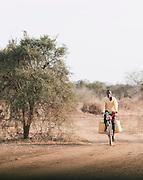 Man on bicycle near Amboseli National Park, Rift Valley Province, Kenya