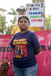 "May 19, 2017 - Miramar, Florida, U.S - Activists protest against recent ""silent raids"", outside the U.S. Immigration and Customs Enforcement building in Miramar, Fla. The protest arose after two local immigrants showed up for their regular check-in at the Miramar immigration office and were detained and deported. (Credit Image: © Orit Ben-Ezzer via ZUMA Wire)"