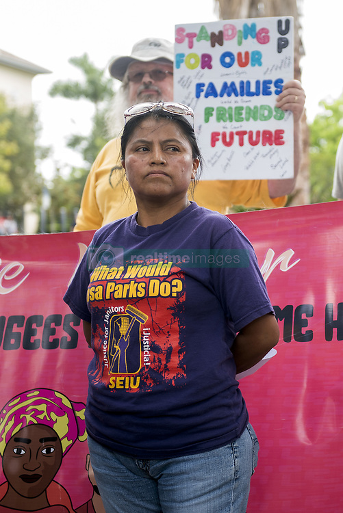 """May 19, 2017 - Miramar, Florida, U.S - Activists protest against recent """"silent raids"""", outside the U.S. Immigration and Customs Enforcement building in Miramar, Fla. The protest arose after two local immigrants showed up for their regular check-in at the Miramar immigration office and were detained and deported. (Credit Image: © Orit Ben-Ezzer via ZUMA Wire)"""