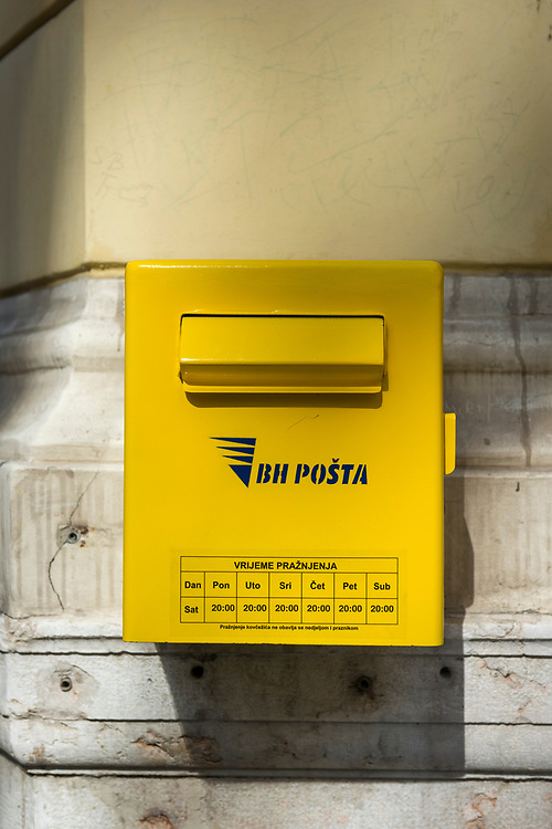 A metal post box for depositing mail on a wall in Sarajevo, Bosnia and Herzegovina