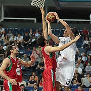 Anadolu Efes's Kerem Gonlum (R) during their Turkish Basketball League Play Off match Anadolu Efes between Pinar Karsiyakaat Sinan Erdem Arena in Istanbul, Turkey, Sunday, May 06, 2012. Photo by TURKPIX