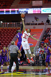29 December 2016:  Gerry Pollard handles the opening jump ball between Dalen Traore and Phil Fayne(10) during an NCAA  MVC (Missouri Valley conference) mens basketball game between the Evansville Purple Aces the Illinois State Redbirds in  Redbird Arena, Normal IL