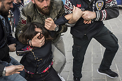 May 1, 2017 - Istanbul, Turkey - Turkish riot police arrest woman protester attempting to defy a ban and march on Taksim Square to celebrate May Day in Istanbul, on May 1, 2017. (Credit Image: © Akin Celiktas/Depo Photos via ZUMA Wire)