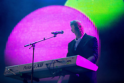 © Licensed to London News Pictures . 09/08/2015 . Siddington , UK . PAUL HUMPHREYS of OMD ( Orchestral Manoeuvres in the Dark ) performing . The Rewind Festival of 1980s music , fashion and culture at Capesthorne Hall in Macclesfield . Photo credit: Joel Goodman/LNP