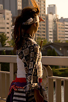 A young woman looking out for her group at the Tenjin Festival (Tenjin Matsuri) in Osaka.