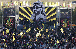 November 21, 2018 - Gaza City, Gaza Strip, Palestinian Territory - Palestinian Fatah supporters take part in a rally to mark the 14th anniversary of the death of late Palestinian leader Yasser Arafat in Gaza City on November 20, 2018  (Credit Image: © Mahmoud Ajjour/APA Images via ZUMA Wire)