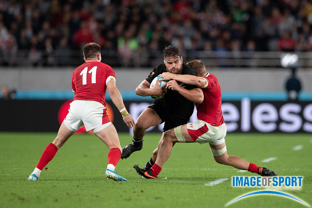 Angus Ta'avao of New Zealand is tackled by during the Rugby World Cup bronze final match between New Zealand and Wales Friday, Nov, 1, 2019, in Tokyo. New Zealand defeated Wales 40-17.  (Flor Tan Jun/Espa-Images-Image of Sport)