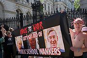 On the day that Britains new Conservative Party Prime Minister, Boris Johnson enters Downing Street to begin his government administration, replacing Theresa May after her failed Brexit negotiations with the European Union in Brussels, Class War protesters stretch their classist banner outside Downing Street, on 24th July 2019, in Westminster, London, England.