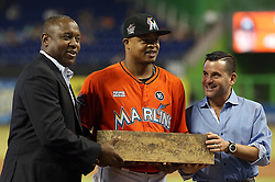 June 4, 2017 - Miami, FL, USA - Michael L. Hill, president of baseball operations for the Miami Marlins, and David  Samson, president of the Miami Marlins, present the pitching rubber from yesterday's game to Edinson Volquez for his no-hitter prior to the Miami Marlins hosting the Arizona Diamondbacks on Sunday, June 4, 2017 at Marlins Park in Miami, Fla. (Credit Image: © Patrick Farrell/TNS via ZUMA Wire)