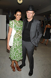 SERENA REES and PAUL SIMONON at a reception hosted by Vogue magazine to launch photographer Tim Walker's book 'Pictures' sponsored by Nude, held at The Design Museum, Shad Thames, London SE1 on 8th May 2008.<br /><br />NON EXCLUSIVE - WORLD RIGHTS