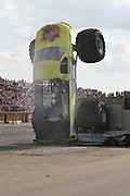 I'm in wheely big trouble: Moment a monster truck got stuck trying to take on a fire engine<br /> <br /> This is the moment a monster truck bit off a little more than it could chew trying to crush a full-sized fire engine. <br /> Driver Lewis Cook, 45, was left red faced after his huge vehicle 'Crusher' failed to clear the obstacle during a freestyle car-crushing competition.<br /> Instead of munching the stationary fire engine beneath its huge tyres, the £100,000 bright yellow truck ended up stranded on its rear end and suffered the indignity of having to be helped down with a crane.<br /> Lewis, who runs a distribution company in East Sussex, had to sit helplessly as flammable liquid leaked on to the piping hot exhaust system.<br /> <br /> He said: 'We were taking part in the freestyle event where drivers have 90 seconds to do whatever they want in front of the judging crowd - burnouts, donuts, those sorts of things.<br /> 'There was also a bus to smash over and the fire engine, which everyone was a bit sceptical about but I fired myself up and decided to go for it.<br /> <br /> 'I hit the fire engine perfectly but it was much harder than I imagined and it didn't 'give' so the next thing I find is that I'm completely vertical and there's nothing I can do about it.'<br /> The truck, which has a 1,800bhp engine and tyres costing £8,000 a set, was stuck for six minutes as crowed watched with anticipation.<br /> Emergency crews then strapped a chain around the front axle to prevent it falling on its roof before slowly pulling it backwards, successfully dislodging it.<br /> The incident, the first of its kind in the UK, took place in front of 10,000 fans on Sunday at the Monster Truck Nationals at the Santa Pod Raceway in Northamptonshire.<br /> Santa Pod, which has been entertaining petrol heads for 45 years, also hosts the FIA European Drag Racing Championships from September 8 to September 11.<br /> ©Exclusivepix
