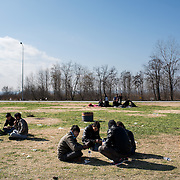 Refugees and migrants waiting at the petrol station near Idomeni. In the last few months the fields near this petrol station have become a transit camp for thousands of refugees and migrants waiting to cross to Greek Macedonian border.