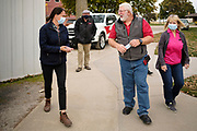 """14 OCTOBER 2020 - KNOXVILLE, IOWA: THERESA GREENFIELD, the Democratic candidate for US Senator from Iowa, (left) talks to MAX SMITH and SHARON SMITH at Smith Fertilizer and Grain. Greenfield toured Smith Fertilizer and Grain in Knoxville and talked to owner Max Smith about her """"Fair Shot for Our Farmers"""" plan to improve Iowa's farm economy. Greenfield is in a tight race with incumbent Republican Senator Joni Ernst.        PHOTO BY JACK KURTZ"""