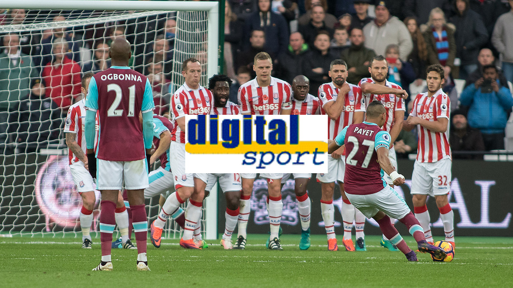 Football - 2016 / 2017 Premier League - West Ham United vs. Stoke City<br /> <br /> Dimitri Payet of West Ham with a late free kick at the end of the first half at The London Stadium.<br /> <br /> COLORSPORT/DANIEL BEARHAM