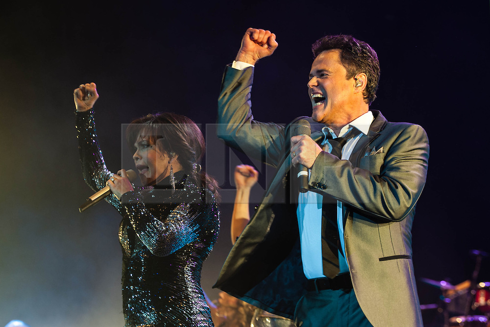 """© Licensed to London News Pictures. 20/01/2013. London, UK.   Donny and Marie Osmond performing live at The O2 Arena, on the opening night of their Donny & Marie Live tour Sunday 20 January 2013.  .Donald Clark """"Donny"""" Osmond (born December 9, 1957) is an American singer, musician, actor, dancer, radio personality, and former teen idol. Donny Osmond has also been a talk and game show host, record producer and author. In the mid 1960s, he and four of his elder brothers gained fame as The Osmonds on the long running variety program, The Andy Williams Show. Donny went solo in the early 1970s covering such hits as """"Go Away Little Girl"""" and """"Puppy Love""""...Olive Marie Osmond (born October 13, 1959) is an American singer, actress, doll designer, and a member of the show business family The Osmonds. Although she was never part of her family's singing group, she gained success as a solo country music artist in the 1970s and 1980s. .For over thirty-five years, Donny and Marie have gained fame as Donny & Marie, partly due to the success of their 1976-79 self-titled variety series, which aired on ABC. The duo also did a 1998-2000 talk show and have been headlining in Las Vegas since 2008.   Photo credit : Richard Isaac/LNP"""