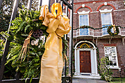 A Christmas wreath decorates the iron gate to the historic Nathaniel Russell House and museum on Meeting Street in Charleston, SC.