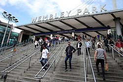 Tottenham Hotspur fans arrive at Wembley Park Underground Station ahead of the Premier League match at Wembley Stadium, London.