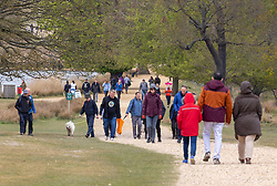 Licensed to London News Pictures. 03/05/2021. London, UK. Members of the public brave the wind and rain as they enjoy a Bank Holiday Monday walk in Richmond Park, South West London. Today, weather forecasters predict high winds and driving rain with temperatures reaching 13c in London and the South East. Yesterday, Health Secretary Dominic Rabb admitted that masks could be with us for the summer as virtually all social restrictions will be lifted by June 21 2021. Photo credit: Alex Lentati/LNP