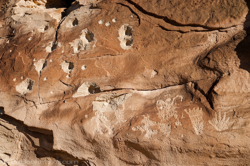 Vandalized and bullet marked Fremont People rock art petroglyph (prehistoric rock carving dated 600-1300 AD) in the Douglas Creek Canyon south of Rangely, Colorado, USA on Bureau of Land Management (BLM) public lands.