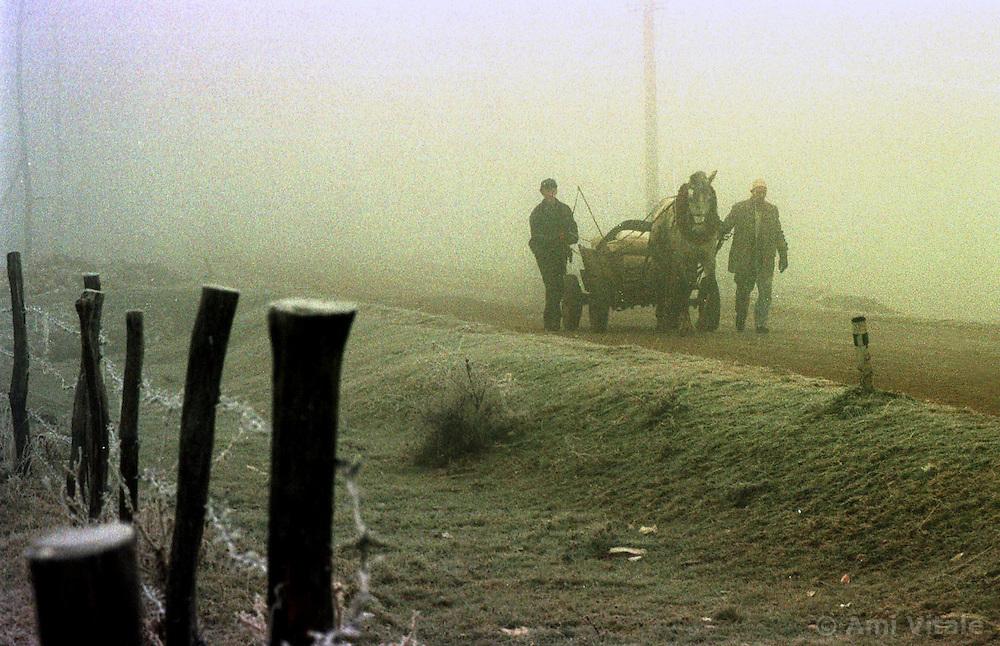 Villagers head to the Sunday market near Kopilic I Ulet in Kosovo Sunday, December 13, 1998.  (Photo by Ami Vitale)