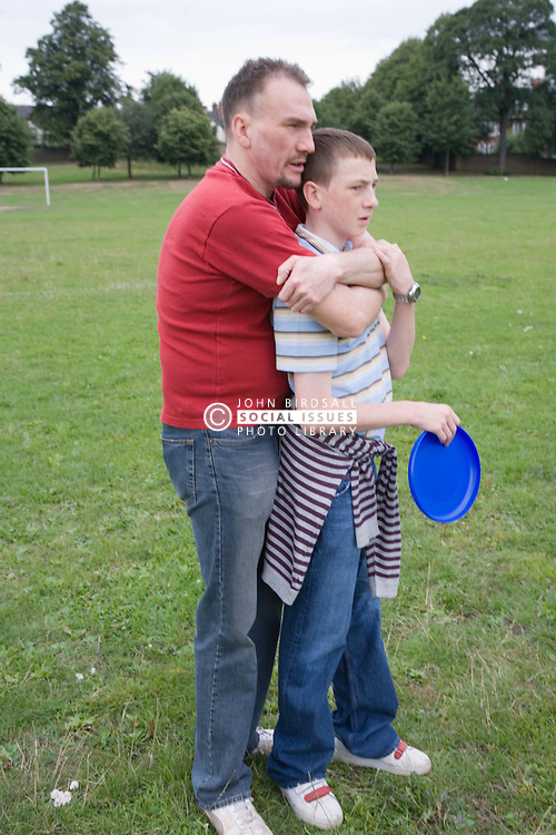 Father and son hugging,