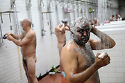 Miners are having a shower at the Tower Colliery complex after a long day underground on Tuesday, June 19, 2007, in Hirwaun, Vale of Neath, South Wales. The time is ripe again for an unexpected revival of the coal industry in the Vale of Neath due to the increasing prize and diminishing reserves of oil and gas, the uncertainties of renewable energy sources, and the technological advancement in producing energy from coal while limiting emissions of pollutants, has created the basis for valuable investment opportunities and a possible alternative to the latest energy crisis. Unity Mine, in particular, has started a pioneering effort to revive the coal industry in the area, reopening after more than 8 years with the intent of exploiting the large resources still buried underground. Coal could be then answer to both, access to cheaper and paradoxically greener energy and a better and safer choice than nuclear energy as a major supply for the decades to come. It is estimated that coal reserves in Wales amount to over 250 million tonnes, or the equivalent of at least 50 years of energy supply, while the worldwide total coal could last for over 200 years as a viable resource compared to only a few decades of oil and natural gas.