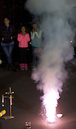 Middletown, New York - People watch a demonstration in a parking lot during Kids Chemistry Night at SUNY Orange on Oct. 24, 2014. The program was sponsored by the college Chemistry Club and the American Chemical Society.