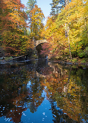 Dunkeld, Perthshire, Scotland, United Kingdom, 10th October 2018.  Spectacular autumn colours in the trees at The Hermitage a famous beauty spot near Dunkeld in Perthshire. Pictured is Hermitage Bridge spanning the River Braan.