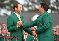 April 8, 2018 - Augusta, GA, USA - Sergio Garcia, left, last years Masters winner, congratulates Patrick Reed after Reed won the Masters at Augusta National Golf Club on Sunday, April 8, 2018, in Augusta, Ga. (Credit Image: © Jason Getz/TNS via ZUMA Wire)