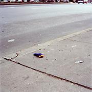 Purple Child's Mitten (with orange trim), Broadway @108th St (west side)<br /> 2-February, 2003 / 1:30PM
