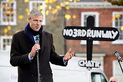 """© Licensed to London News Pictures. 19/11/2016. Richmond, UK. Former conservative MP ZAC GOLDSMITH speaking on stage. Campaigners take part in a demonstration against the expansion of Heathrow Airport and the building of a third runway. Former conservative MP Zac Goldsmith is due to take part in a series of events in which some activists have threatened """"direct action"""". Photo credit: Ben Cawthra/LNP"""