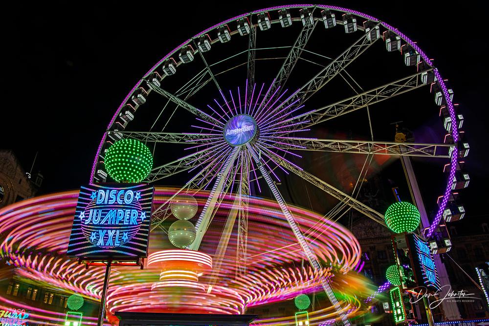 Dam Square Fun Fair Carnival rides at night, Amsterdam, North Holland, Netherlands