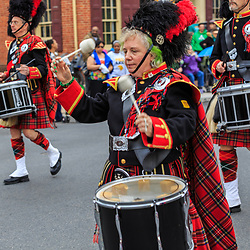 York, PA / USA - March 12, 2016:  Drummers with The Kiltie Band of York maintain the beat as the band marches in the annual Saint Patrick's Day Parade